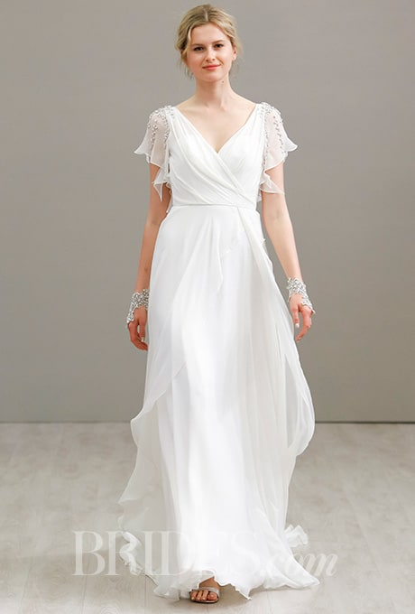 Jlm couture at bridal fashion week delica bridal for Flowy wedding dress with sleeves